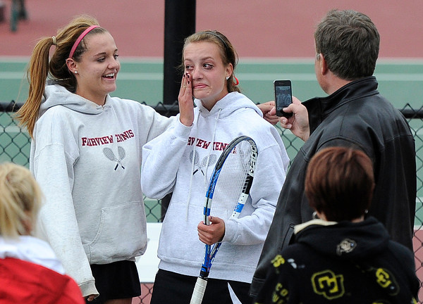 "Fairview High School's Hayley Young, right, wipes tears from her eyes while having a picture taken with teammate Jessee Clauson after winning the Girls class 5A #2 doubles championship match against Cherry Creek on Friday, May 11, at the Gates Tennis Center in Denver. For more photos of the matches go to  <a href=""http://www.dailycamera.com"">http://www.dailycamera.com</a><br /> Jeremy Papasso/ Camera"