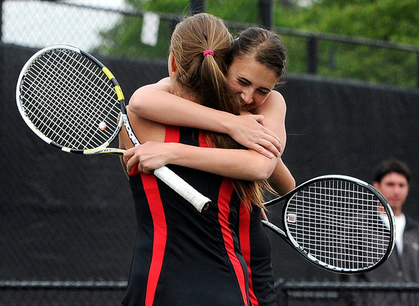 "Fairview High School's Megan Thayer hugs teammate Paris Hogan after winning the Girls class 5A #1 doubles championship match against Cherry Creek on Friday, May 11, at the Gates Tennis Center in Denver. For more photos of the matches go to  <a href=""http://www.dailycamera.com"">http://www.dailycamera.com</a><br /> Jeremy Papasso/ Camera"
