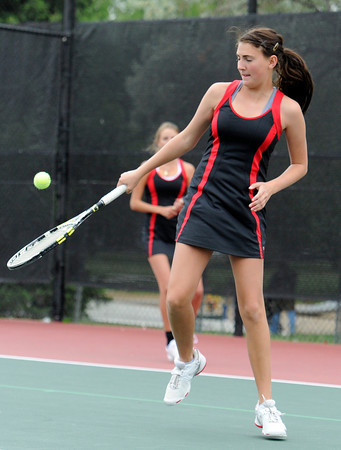 """Fairview High School's Paris Hogan returns the ball during the Girls class 5A #1 doubles match championship match against Cherry Creek on Friday, May 11, at the Gates Tennis Center in Denver. For more photos of the matches go to  <a href=""""http://www.dailycamera.com"""">http://www.dailycamera.com</a><br /> Jeremy Papasso/ Camera"""