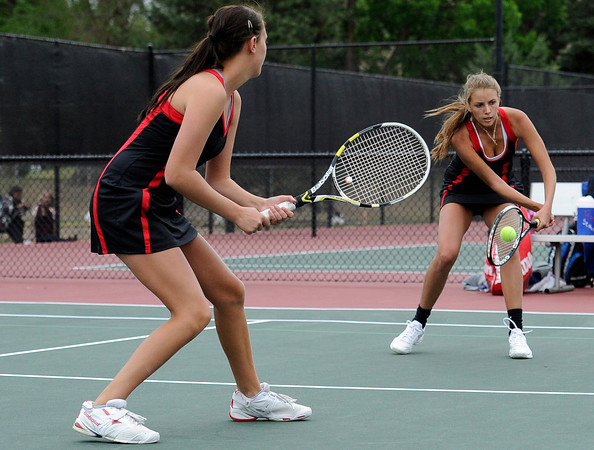 "Fairview High School's Megan Thayer, right, returns the ball while teammate Paris Hogan watches during the Girls class 5A #1 doubles championship match against Cherry Creek on Friday, May 11, at the Gates Tennis Center in Denver. For more photos of the matches go to  <a href=""http://www.dailycamera.com"">http://www.dailycamera.com</a><br /> Jeremy Papasso/ Camera"