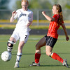 Monarch's Lizzy Powell (left) kicks the ball away from Fairview's Daphnee Morency (right) during their soccer game in Louisville, Colorado May 1, 2011.  CAMERA/MARK LEFFINGWELL
