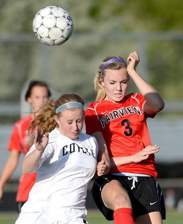 Monarch's Megan Lacy (left) and Fairview's Reci Smith (right) bump going for the ball during their soccer game in Louisville, Colorado May 1, 2012. CAMERA/MARK LEFFINGWELL