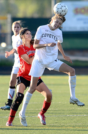 Monarch's Katie Nelson (right) heads the ball away from Fairview's Pyrenee Steiner (left)  during their soccer game in Louisville, Colorado May 1, 2012. CAMERA/MARK LEFFINGWELL