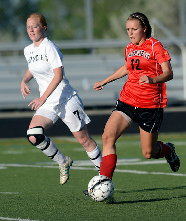 Fairview's Daphnee Morency (right) races past Monarch's Lizzy Powell (left) with the ball during their soccer game in Louisville, Colorado May 1, 2012. CAMERA/MARK LEFFINGWELL