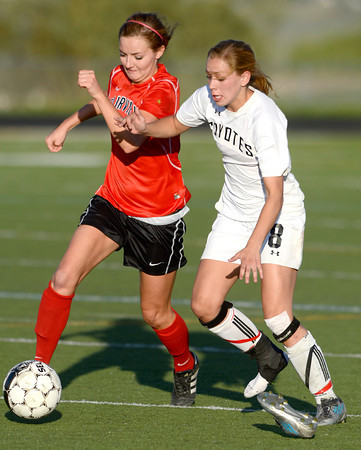 Monarch's Cassie Owens (right) looses her shoe racing Fairview's Megan Higgins (left) for the ball during their soccer game in Louisville, Colorado May 1, 2012. CAMERA/MARK LEFFINGWELL
