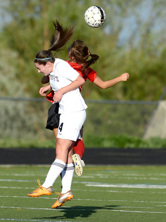 Monarch's Nicole Barbour (front) and Fairview's Olivia Fear (back) go fro the ball during their soccer game in Louisville, Colorado May 1, 2012. CAMERA/MARK LEFFINGWELL