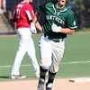 Randy Meyers -- The Morning Journal Elyria Catholic's Leighton Banjoff runs the bases after hitting a home run against Lutheran West.