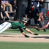 Jace Drwal of Elyria Catholic is picked off at first base as John Smolik of Lutheran West applies the tag. Randy Meyers -- The Morning Journal