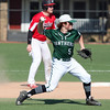 Randy Meyers -- The Morning Journal Elyria Catholic shortstop Tony LoParo holds the runner at second and throws to first for the out against Lutheran West.