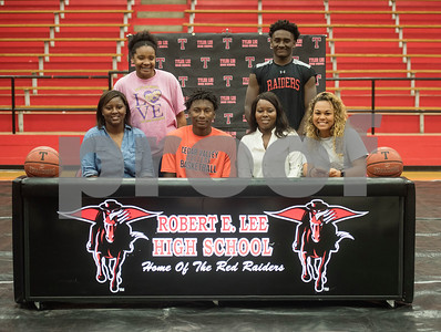 Robert E. Lee High School student Curtis Jones is surrounded by his family after signing his letter of intent to play collegiate basketball at Cedar Valley College on Wednesday May 16, 2018. Pictured from left: Iishia Jones, I'Onna Jones, Curtis Jones, Courtney Lewis, Jamal Jones and Jayah Loftin.   (Sarah A. Miller/Tyler Morning Telegraph)