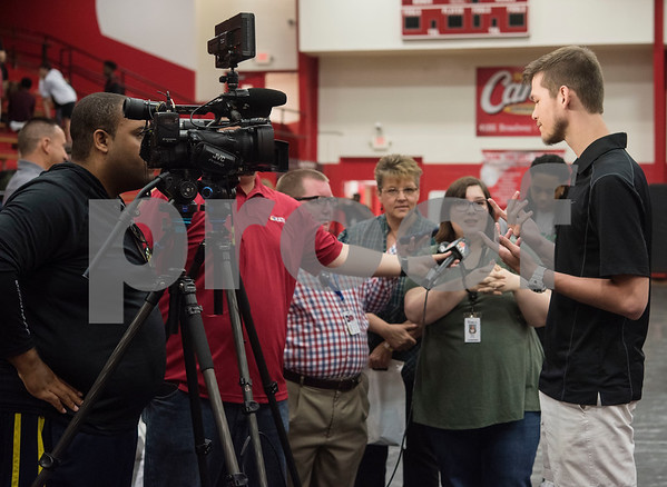 Robert E. Lee High School graduate Korbin Casey uses sign language to answer questions from reporters after he signed his letter of intent to play collegiate basketball on Wednesday May 16, 2018. Casey will play at Southwest Collegiate Institute for the Deaf. Casey played basketball at REL with assistance from a sign language interpreter.   (Sarah A. Miller/Tyler Morning Telegraph)