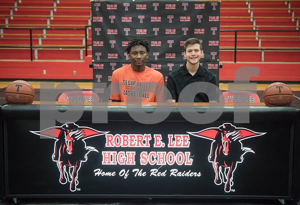 Robert E. Lee High School student Curtis Jones and 2017 graduate Korbin Casey sign his letters of intent to play collegiate basketball on Wednesday May 16, 2018. Jones will play at Cedar Valley College and Casey will play at Southwest Collegiate Institute for the Deaf.   (Sarah A. Miller/Tyler Morning Telegraph)