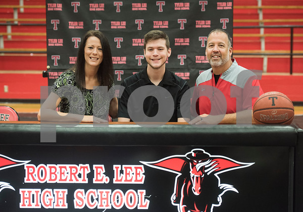 Robert E. Lee High School graduate Korbin Casey takes a photograph with his mother, Kristi Casey, left, and father Kyle Casey, right, after signing his letter of intent to play collegiate basketball on Wednesday May 16, 2018. Casey will play at Southwest Collegiate Institute for the Deaf. Casey played basketball at REL with assistance from a sign language interpreter.   (Sarah A. Miller/Tyler Morning Telegraph)