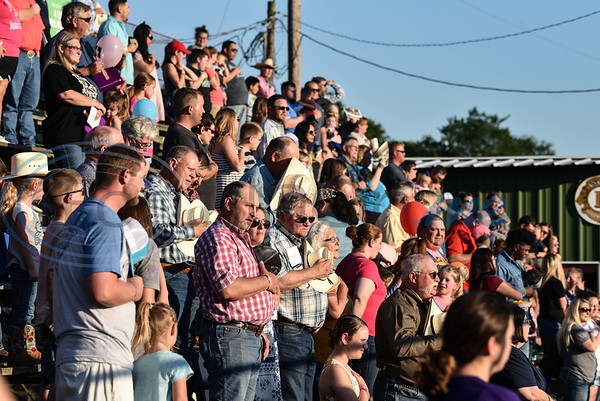 Rodeo goers stand for the National Anthem at the 57th TOPS in Texas Rodeo on Thursday, May 16. The annual three-night event took place in Jacksonville and included steer wrestling, bull riding, calf roping, mutton busting, a calf scramble and more. (Jessica T. Payne/Tyler Morning Telegraph)