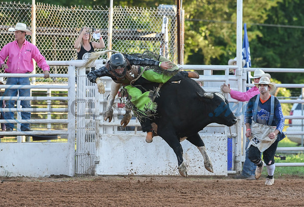 Zach Miles of Nixon, Texas jumps off a bull during the bulling riding event at the 57th TOPS in Texas Rodeo on Thursday, May 16. The event took place in Jacksonville and also included steer wrestling, bareback riding, mutton busting and more. (Jessica T. Payne/Tyler Morning Telegraph)