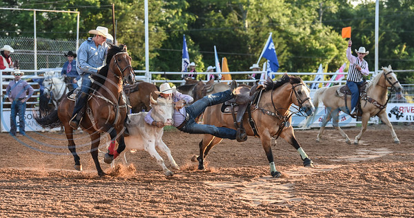 Jay Williamson of Iowa, Louisiana makes his move in the steer wrestling event at the 57th TOPS in Texas Rodeo in Jacksonville. The three-night event started on Thursday, May 16 and went through Sunday.  (Jessica T. Payne/Tyler Morning Telegraph)