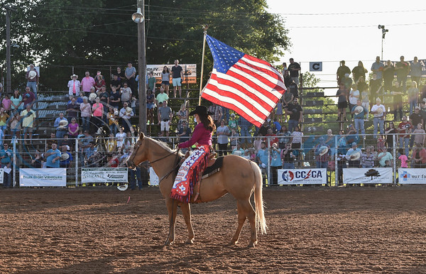 Miss Jacksonville Rodeo 2018 holds the flag during the National Anthem at the 57th TOPS in Texas Rodeo. The three-night event started on Thursday, May 16 and went through Sunday.  (Jessica T. Payne/Tyler Morning Telegraph)