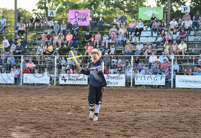 A rodeo clown throws a weezer into the crowd at the 57th TOPS in Texas Rodeo on Thursday, May 16. The event took place in Jacksonville and included bull riding, steer wrestling, bareback riding, mutton busting and more. (Jessica T. Payne/Tyler Morning Telegraph)
