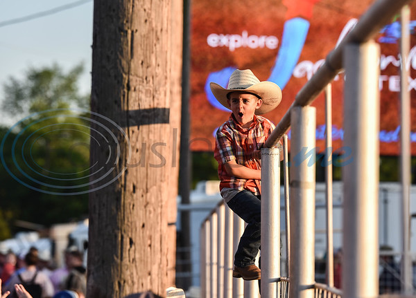 A young cowboy cheers during an event at the 57th TOPS in Texas Rodeo in Jacksonville. The three-night event started on Thursday, May 16 and went through Sunday.  (Jessica T. Payne/Tyler Morning Telegraph)