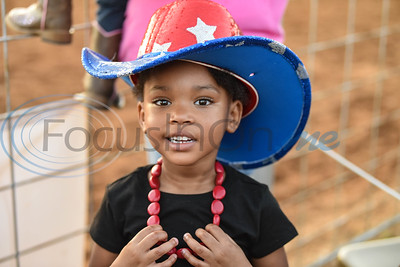 Camilla Jones, 5, smiles for a photo at the 57th TOPS in Texas Rodeo. The three-night event started on Thursday, May 16 and went through Sunday in Jacksonville.  (Jessica T. Payne/Tyler Morning Telegraph)