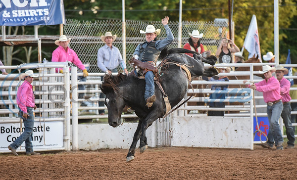 A cowboy holds on tight during the bareback riding event at the 57th TOPS in Texas Rodeo on Thursday, May 16. The three-night event took place in Jacksonville and also included steer wrestling, bull riding, mutton busting and more. (Jessica T. Payne/Tyler Morning Telegraph)