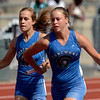 Longmont's Julie Morrison hands off to Terry Riddell in a 4x200 relay prelim Thursday May 17, 2012 during the State Track and Field Championship in Lakewood. (Lewis Geyer/Times-Call)