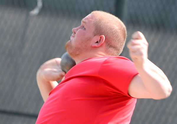 Skyline's Chico Feltenberger pushes the shot put during the 2012 State Track and Field Championships in Lakewood, Colorado May 17, 2012. CAMERA/ MARK Leffingwell