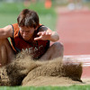 Mead's Jared Hernandez sprays sand after landing in the 2A triple jump during the 2012 State Track and Field Championships in Lakewood, Colorado May 17, 2012. CAMERA/ MARK Leffingwell