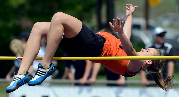 Erie's Nicole Hulet clears the bar in the high jump Thursday May 17, 2012 during the State Track and Field Championship in Lakewood. (Lewis Geyer/Times-Call)