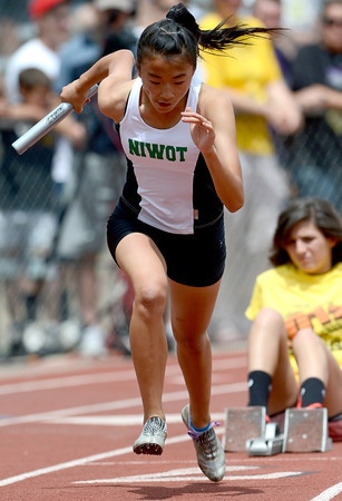 Niwot's Amber Liu starts the 4A Girls sprint medley during the second day of the State Track and Field Championships in Lakewood, Colorado May 18, 2012. CAMERA/ MARK Leffingwell