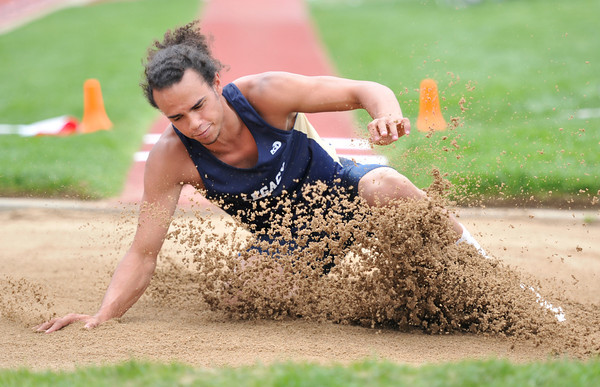 Legacy High School's Camren McWee slides out in the sand in the boys 5A long jump during the 2012 State Track and Field Championships Friday, May 18, 2012 at Jeffco Stadium in Lakewood.<br /> (Matthew Jonas/Times-Call)