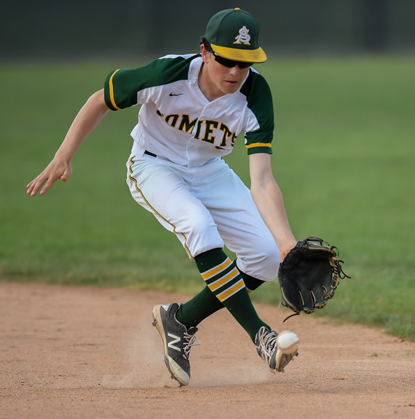 Amherst's Cameron Karnik fields a ground ball in the top of the second inning.  Eric Bonzar — The Morning Journal