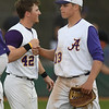 Avon pitcher Logan Doenges (13) bumps fists with teammate Neil Strodtbeck after a strikeout. Eric Bonzar — The Morning Journal