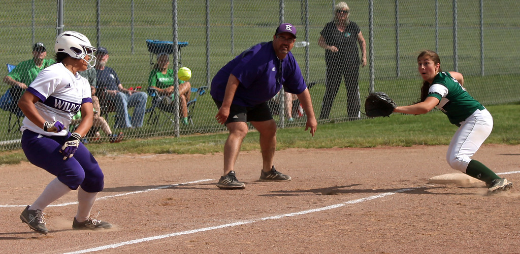 . Keystone\'s Sammie Stefan is caught too far off of third base as the throw comes in to Allie Gray of Holy Name. Randy Meyers -- The Morning Journal
