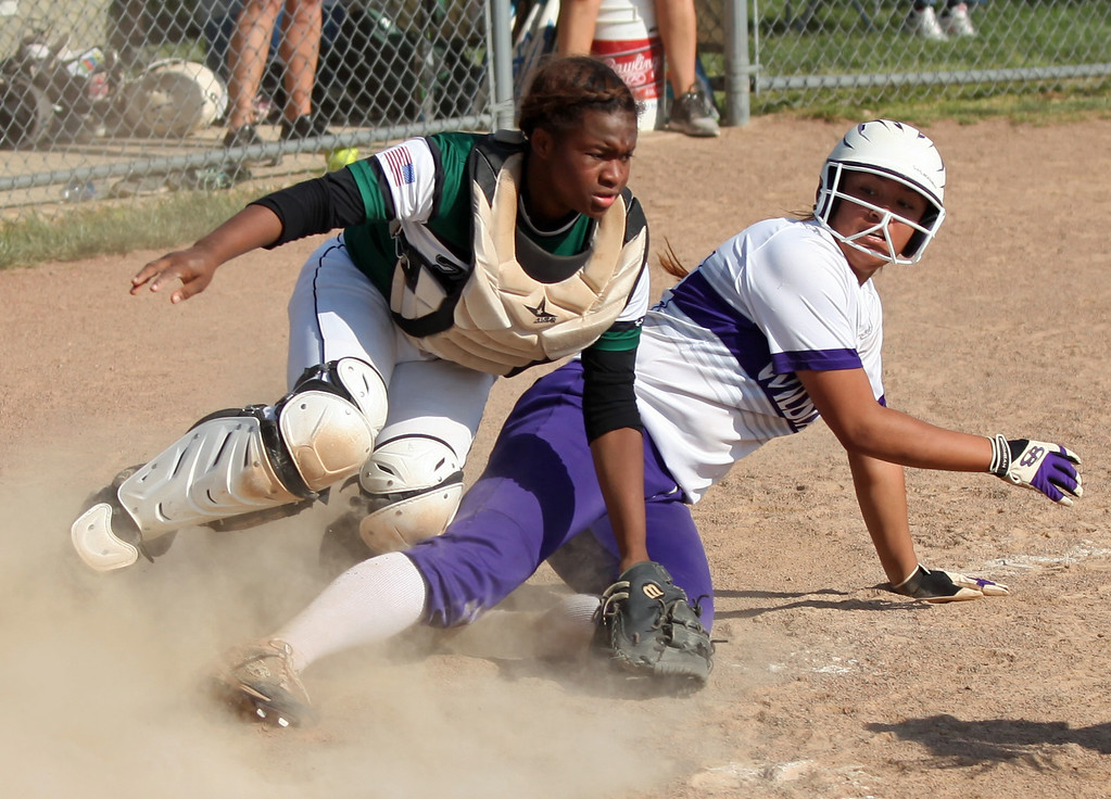 . The ball gets away from Holy Name catcher Annessa Whitlow as Keystone\'s Sammie Stefan slides in safely. Randy Meyers -- The Morning Journal