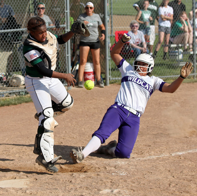 . Holy Name catcher Annessa Whitlow can\'t control the ball at home plate as Keystone\'s Sammie Stefan slides in safely. Randy Meyers -- The Morning Journal