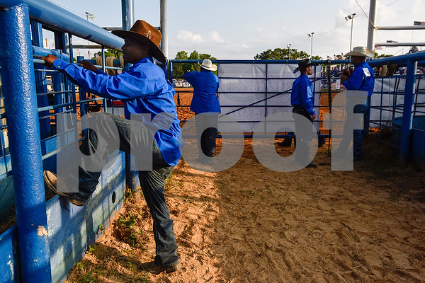 Jermy Owens, left, stands with other rodeo committee members as he watches cattle during the 30th annual Lindale Championship Rodeo in Lindale, Texas, on Thursday, May 18, 2017. The rodeo featured everything from cattle roping and mutton busting to bull riding and calf scrambles. (Chelsea Purgahn/Tyler Morning Telegraph)
