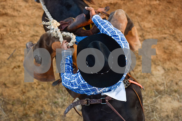 A man competes in bareback riding during the 30th annual Lindale Championship Rodeo in Lindale, Texas, on Thursday, May 18, 2017. The rodeo featured everything from cattle roping and mutton busting to bull riding and calf scrambles. (Chelsea Purgahn/Tyler Morning Telegraph)