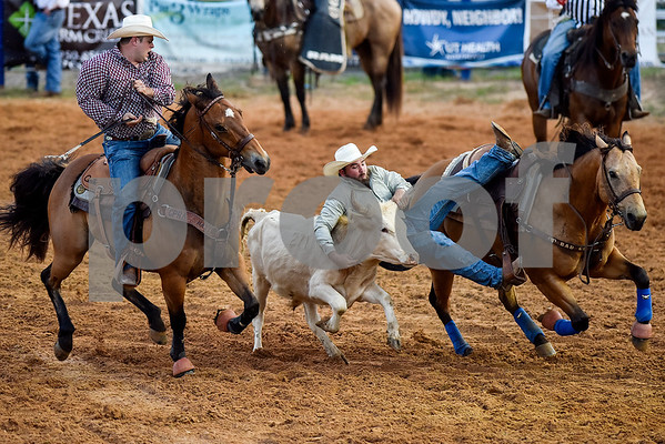People compete in steer wrestling during the 30th annual Lindale Championship Rodeo in Lindale, Texas, on Thursday, May 18, 2017. The rodeo featured everything from cattle roping and mutton busting to bull riding and calf scrambles. (Chelsea Purgahn/Tyler Morning Telegraph)