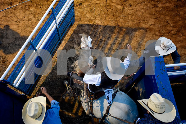 A man competes in the saddle bronc riding during the 30th annual Lindale Championship Rodeo in Lindale, Texas, on Thursday, May 18, 2017. The rodeo featured everything from cattle roping and mutton busting to bull riding and calf scrambles. (Chelsea Purgahn/Tyler Morning Telegraph)