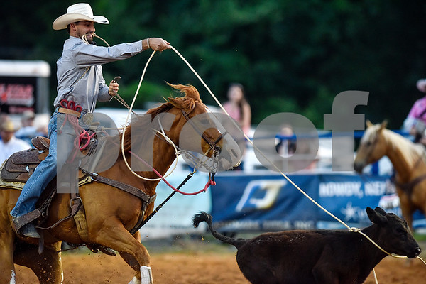 A man competes in calf roping during the 30th annual Lindale Championship Rodeo in Lindale, Texas, on Thursday, May 18, 2017. The rodeo featured everything from cattle roping and mutton busting to bull riding and calf scrambles. (Chelsea Purgahn/Tyler Morning Telegraph)