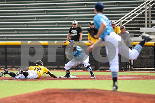 Coastal Bend College's player number 24 prepares to catch the ball at first base Tyler Junior College's Jarel McDade slides back to first base during the District C tournament at Mike Carter Field in Tyler, Texas, on Thursday, May 18, 2017. (Chelsea Purgahn/Tyler Morning Telegraph)