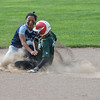 Elyria Catholic's Sam Filiaggi collides with Oberlin's Alyssa Hicks-Watson as she slides into second base safe. Eric Bonza r— The Morning Journal