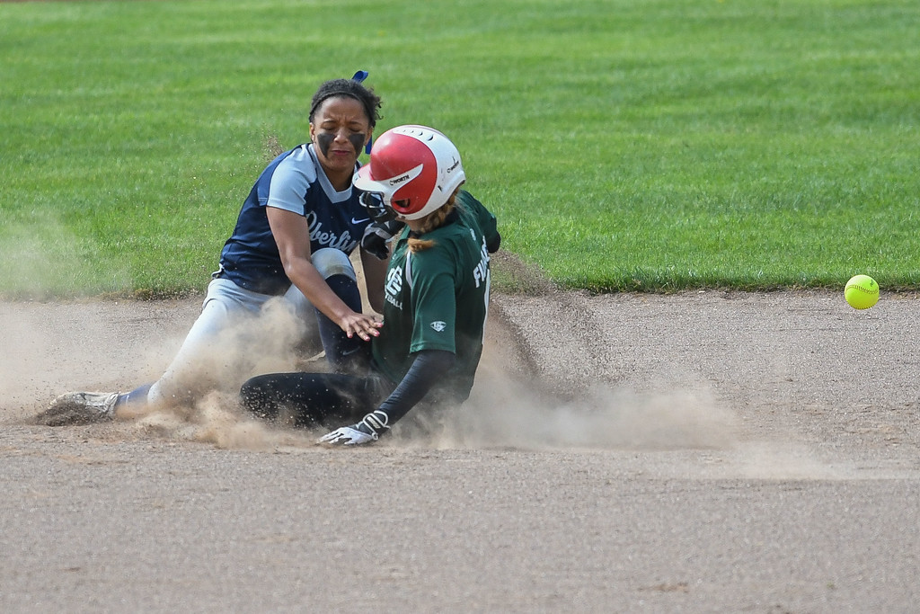 . Elyria Catholic\'s Sam Filiaggi collides with Oberlin\'s Alyssa Hicks-Watson as she slides into second base safe. Eric Bonza r� The Morning Journal