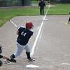 Oberlin's Makenzie Tallman (44) ropes a single down the third base line.  Eric Bonzar — The Morning Journal