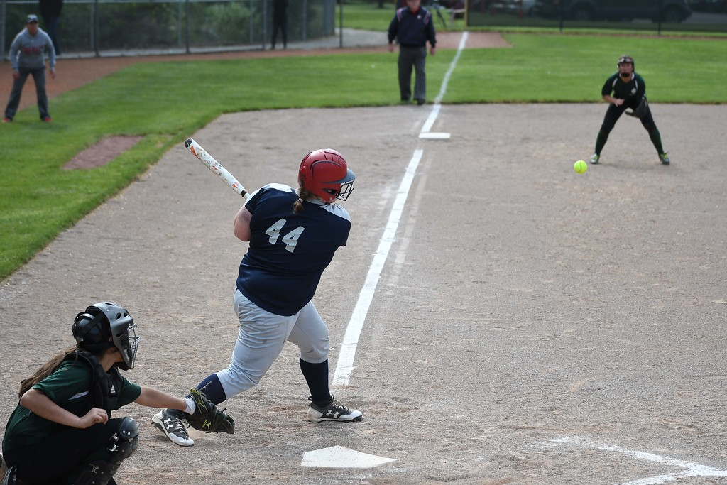 . Oberlin\'s Makenzie Tallman (44) ropes a single down the third base line.  Eric Bonzar � The Morning Journal