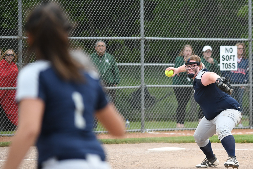 . Oberlin third baseman Makenzie Tallman throws to first baseman Victoria Jackson (1). Eric Bonzar � The Morning Journal