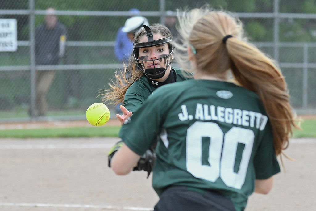 . Elyria Catholic first baseman Bridget Pronesti has to come off the bag to field a ground ball and toss it to second baseman Julia Allegretto, who\'s covering first. Eric Bonzar � The Morning Journal