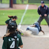 Elyria Catholic catcher Kaylie Griffin watches as her throw to third baseman Olivia Madera is not in time. Eric Bonzar — The Morning Journal