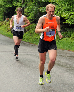 Kris Freeman (left), of Thornton, NH, is only a couple of steps behind his brother, Justin, of New Hampton, during the 51st Mount Washington Road Race, which was held on Saturday, June 18th, 2011, in Pinkham Notch, NH, Kris finished 14th, with a time of 1:07:46, while Justin was 8th, clocking a 1:06:28. Runners competed on a grueling 7.6 mile course, up the Mount Washington Auto Road, finishing near the 6,288' summit, which is the highest peak in the northeastern United States.